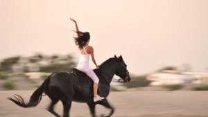 Woman riding a galloping horse